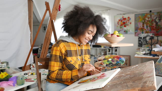 Young afro woman drawing Young afro woman drawing painting activity stock videos & royalty-free footage