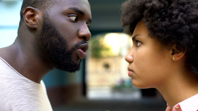 young afro-american couple arguing outdoor, misunderstanding, jealous spouse - walczyć filmów i materiałów b-roll