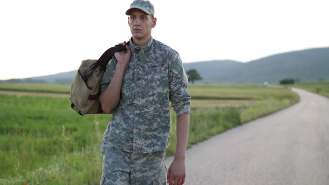 Young Amputee Soldier Coming Home Handsome Young Amputee Soldier Coming Home  From Serving Military us military stock videos & royalty-free footage