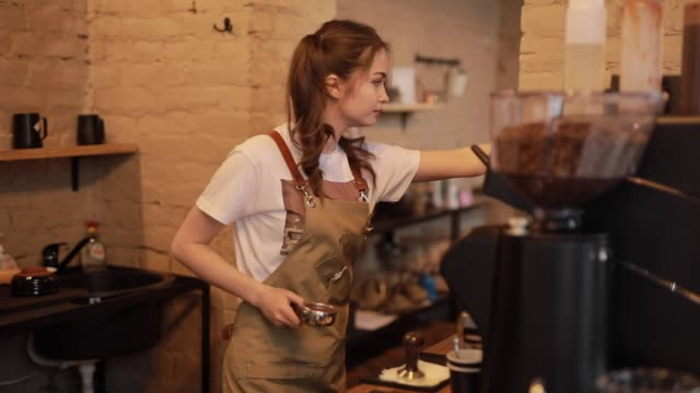 Young and cheerful barista woman make a coffee video