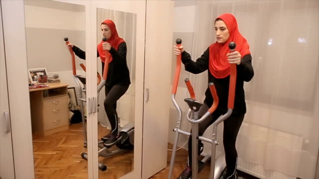 Young Arab woman exercise at home video