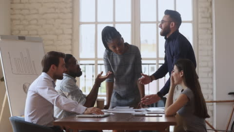 Young arabian manager giving high five to biracial colleague. Diverse teammates watching cheerful young arabian manager giving high five to biracial colleague, coming to common decision agreement at mixed race business people brainstorming meeting in office. agreement stock videos & royalty-free footage