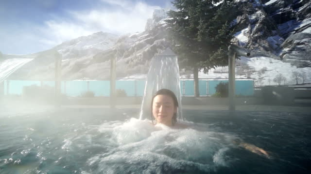Young Asia woman enjoy hot spring in Switzerland video