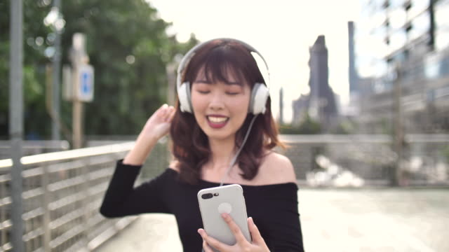 Young asia woman listening to music
