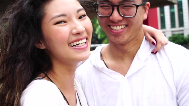 Young Asian Couple Taking Selfie video