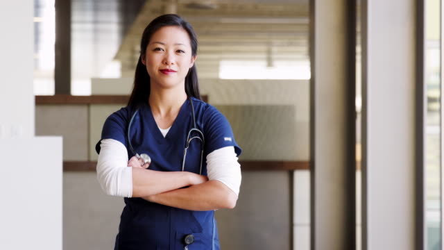 Young Asian female doctor wearing scrubs