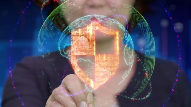 vídeos y material grabado en eventos de stock de jóvenes de asia mujer toque futurista interfaz holográfico y activa el icono de escudo - shield