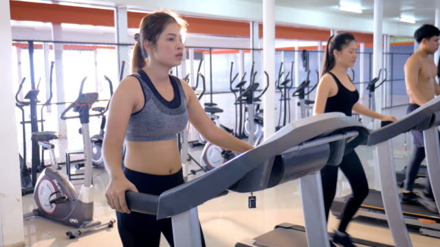 Young Asian fitness woman cardio workout in gym, Healthy lifestyle and cardio training concept video