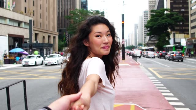 Young Asian Girl Lead by the Hand of Her Boyfriend - Follow Me Concept Romantic Young Asian Couple east asian ethnicity stock videos & royalty-free footage