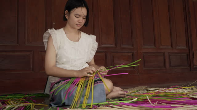 Young Asian girl practice and learning about bamboo wickerwork