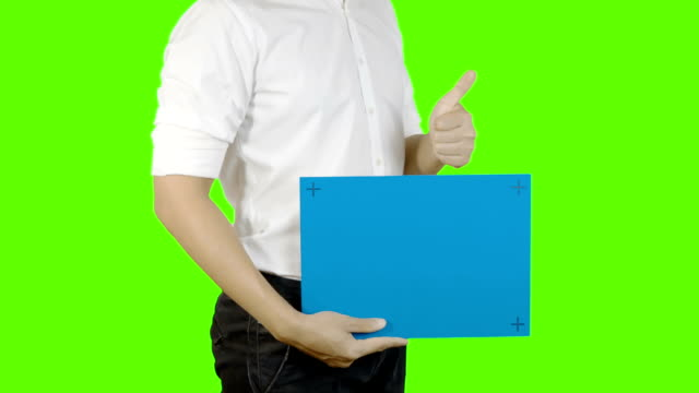 Young asian man holding a blank signboard,Blue screen. video