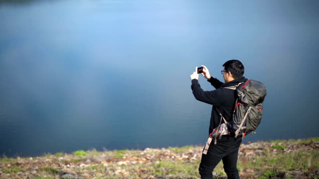 Young Asian Man Taking a Panorama Photo from his Mobile Phone video