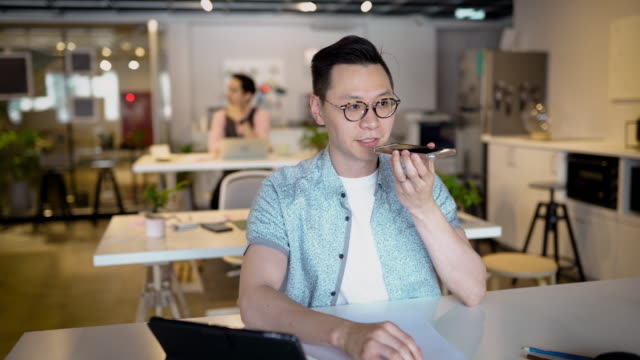 Young Asian Man Working In Office