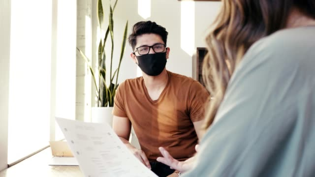 young asian meets potential employer in coffee shop for interview - businessman covid mask video stock e b–roll