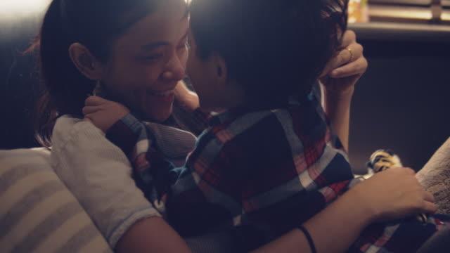 vídeos de stock e filmes b-roll de young asian mother and son cuddling and big hugging at home. - aconchegante