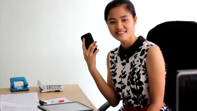 Young Asian Office Worker Takes A Call video