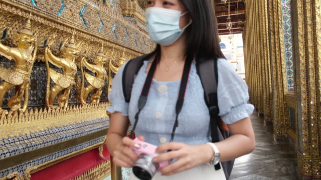 Young Asian tourist woman sightseeing at royal temple