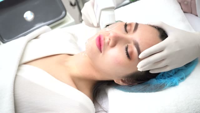 Young Asian woman getting IPL and laser treatment by beautician at beauty clinic Young Asian woman getting IPL and laser treatment by beautician at beauty clinic beautician stock videos & royalty-free footage