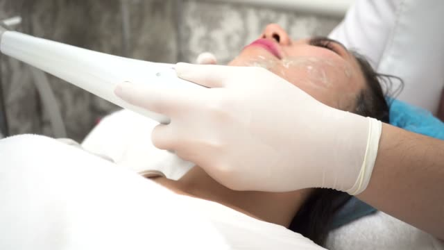 young asian woman getting ipl and laser treatment by beautician at beauty clinic - spa facial stock videos & royalty-free footage