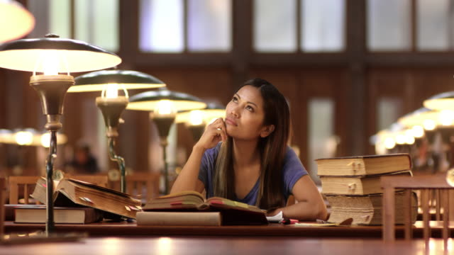 DS Young Asian woman pondering in the library video