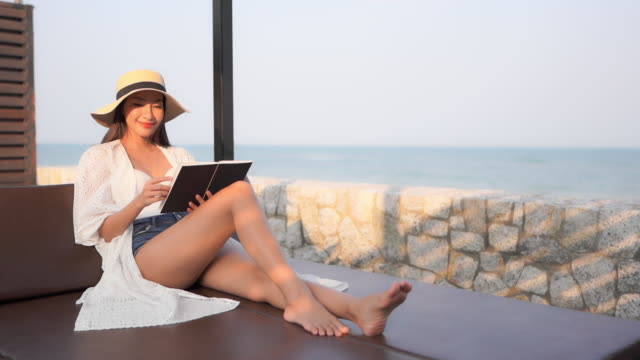Young asian woman read book with outdoor nature view