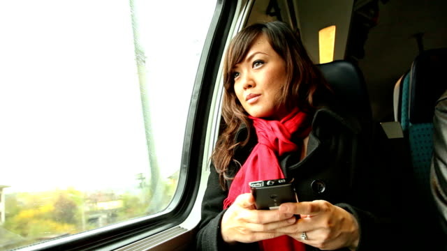 HD: Young Asian Woman Texting on Passenger Train video
