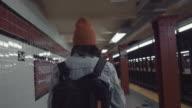 istock Young asian woman walking on subway platform. 1063206170