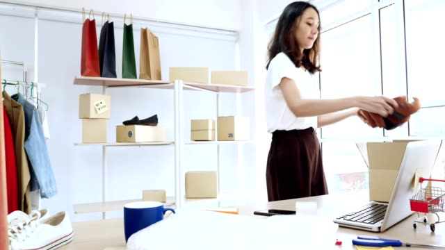 Young asian woman with startup small business entrepreneur freelance working at home video