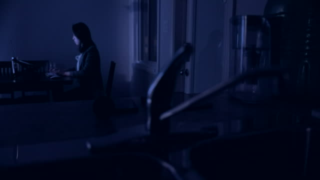 young asian woman working late at home young asian woman working late at home. surfing the net stock videos & royalty-free footage