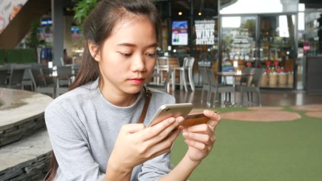 young Asian women shopping online video