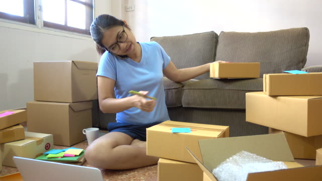 Young asian women using phone to check e-mail inbox order from the customer