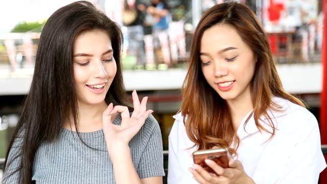 Young Asian women using phone. video