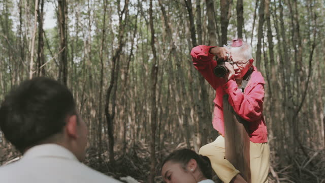 young at heart of photographer grandmother candid-stock video video