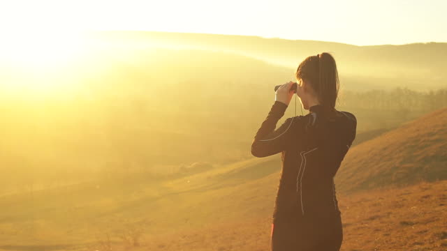 Young athlete woman in the nature exploring the hills. video