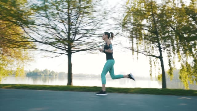 Young athlete woman running in park.