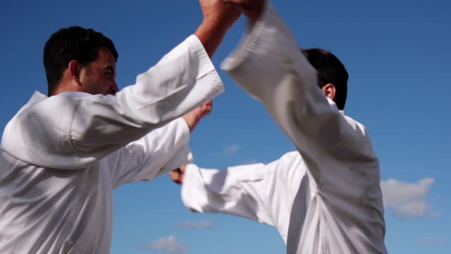 Young Athletes Fighting For Karate And Extreme Combat Sport
