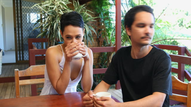 Young Attractive Australian Aboriginal Couple Drinking Tea at Home video