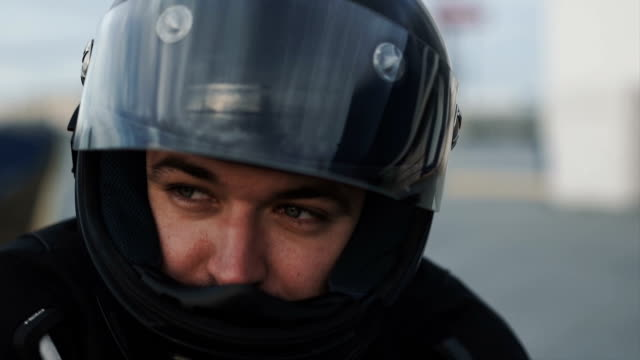 young attractive motorcyclist with black helmet on street. Man motorcycle biker young attractive motorcyclist with black helmet on street. Man biker crash helmet stock videos & royalty-free footage