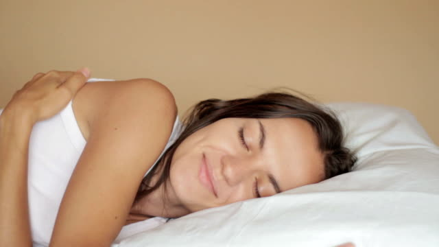 Young attractive sleeping woman video