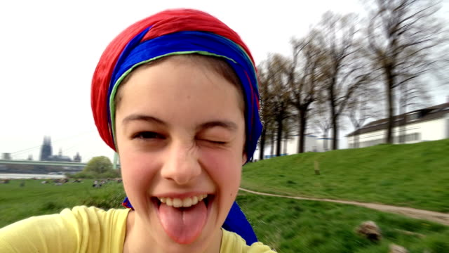 Young, attractive Teenage Girl taking Selfies and pulling faces video
