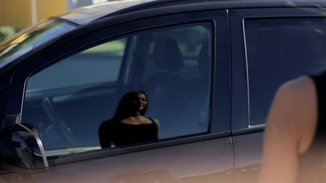 young attractive woman gets in the new car video