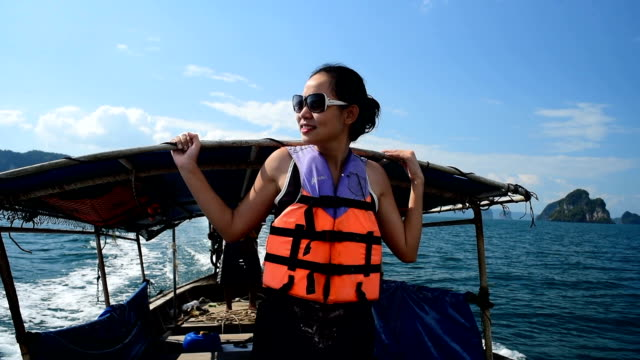 Young attractive woman in longtail boat video