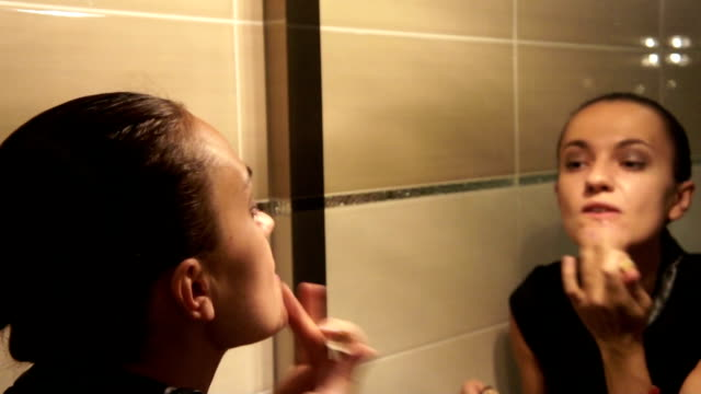 Young attractive woman is doing make-up video