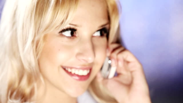 HD: Young attractive woman talking on the phone video