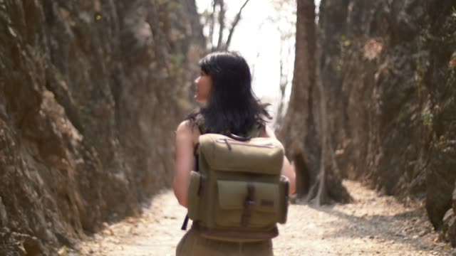 young backpacker travelling in rock mountain thailan video
