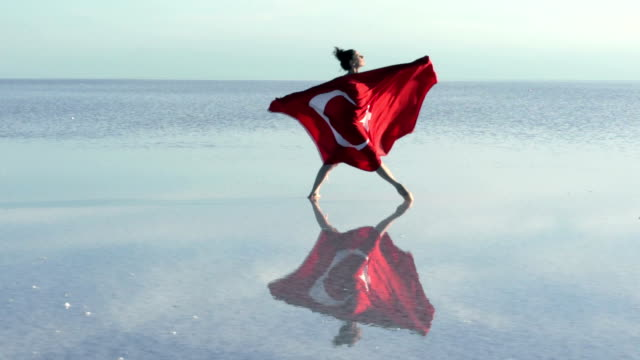Young ballerina on the water with Turkish Flag video