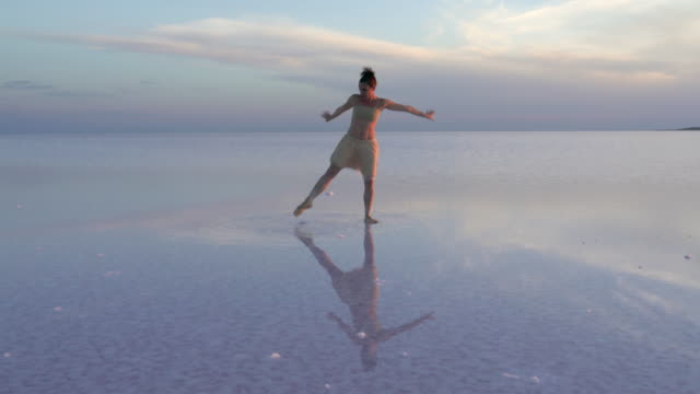 Young ballerina solo dancing on the salt lake video