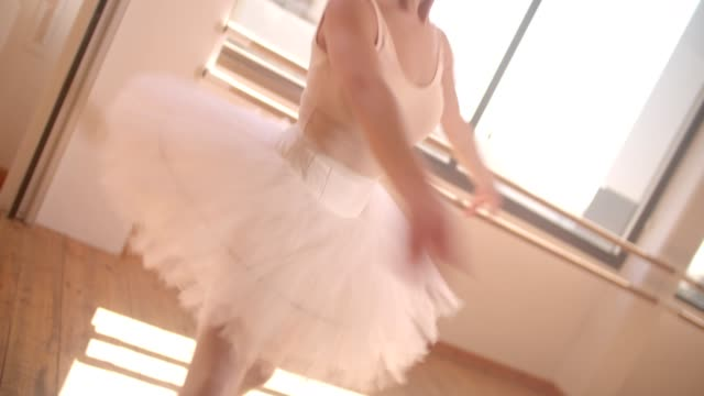 Young ballerina twirling while dancing in ballet studio video