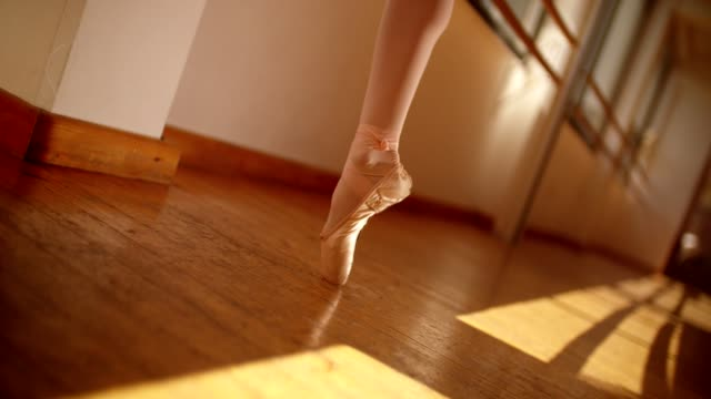 Young ballet dancer balancing en pointe in ballet pumps video