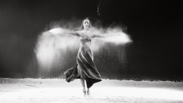 Young ballet dancer jumping into white powder cloud video